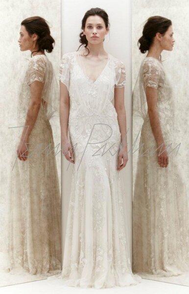 Vestido de novia con encaje y mangas