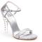 Sandalia de novia en color plateado con tacón transparente e incrustaciones de cristales - Foto Stuart Weitzman