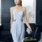 Vestido 8T251 Rosa Clará Fiesta 2015 azul pastel con original corte y aplicaciones en la cintura.