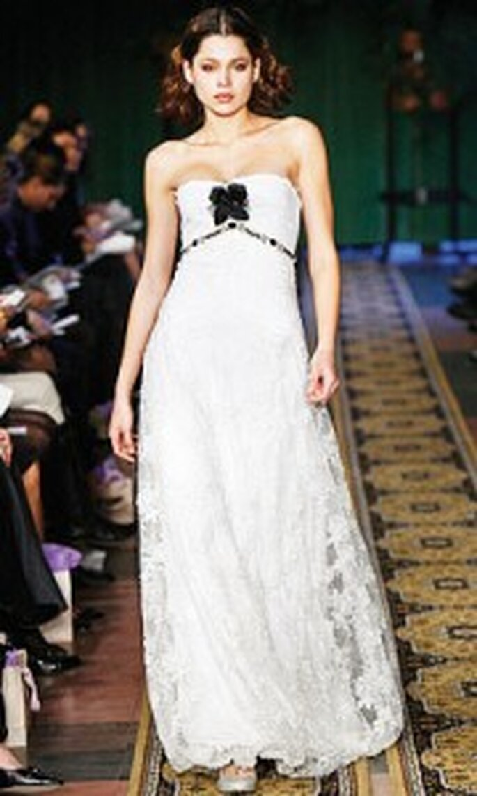 White wedding dress with black rose detail by Claire Pettibone