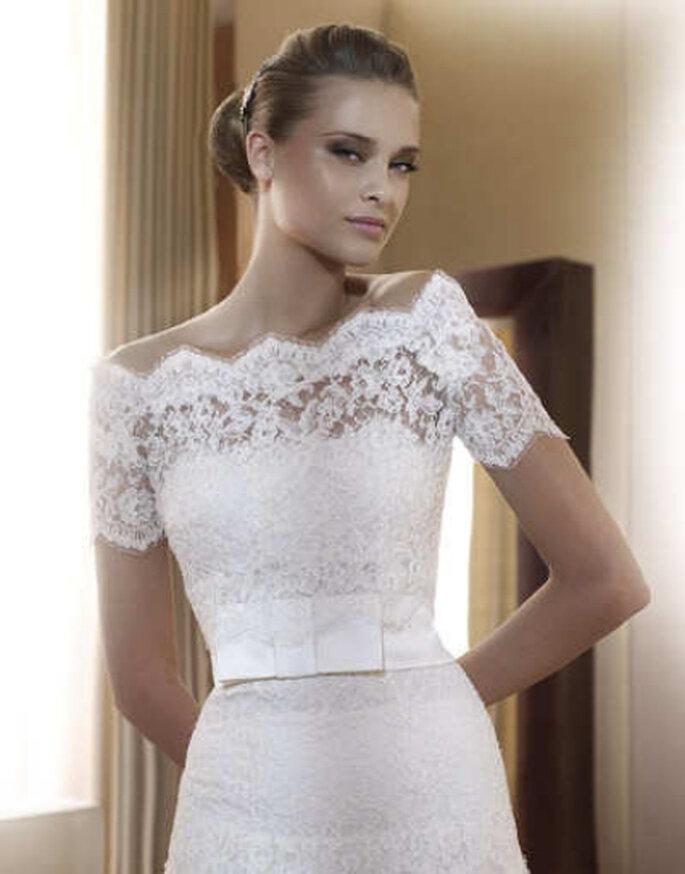 Un delicado vestido con parte superior íntegramente realizada en encaje