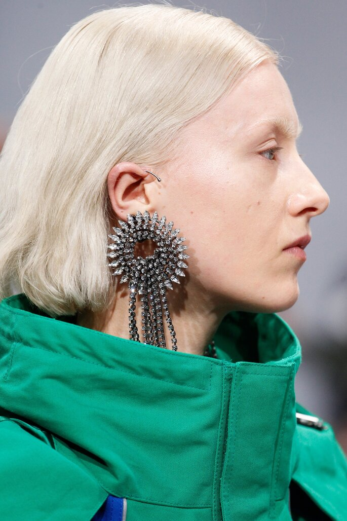 holding-celine-balenciaga-earrings