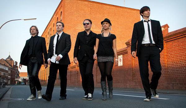 Beispiel: Bandmitglieder, Foto: ambiente.