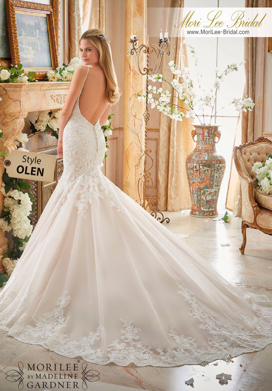 Dress Style OLEN  ALENCON LACE APPLIQUES ON TULLE WITH WIDE SCALLOPED HEMLINE  Available in Three Lengths: 55, 58, 61. Colors Available: White, Ivory, Ivory/Champagne