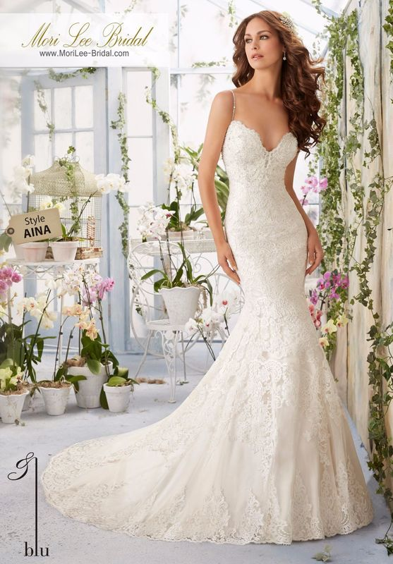 """Dress Style AINA Scalloped Alencon Lace Edging Contours The Net Gown With Appliques And Crystal Beading  Available in Three Lengths: 55"""", 58"""", 61"""". Colors available: White, Ivory, Ivory/Light Gold, Ivory/Blush."""