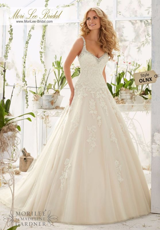 Dress Style OLNX Crystal Beaded Edging Meets The Alencon Lace Appliques On The Tulle Ball Gown  Colors available: White/Silver, Ivory/Silver, Light Gold/Silver.