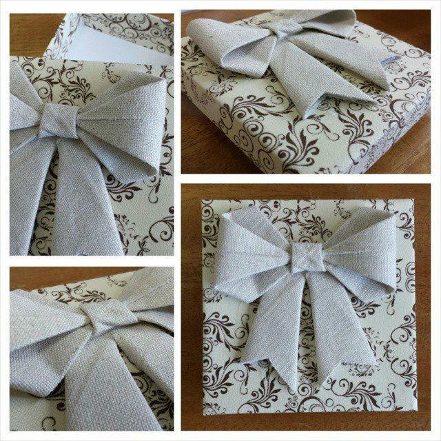Caixa 10x10x2,5cm, ideal para doces, gravata, sabonetes e etc. feito em tricoline estampado e aplicação de um mega laço de origami feito em linho rústico.