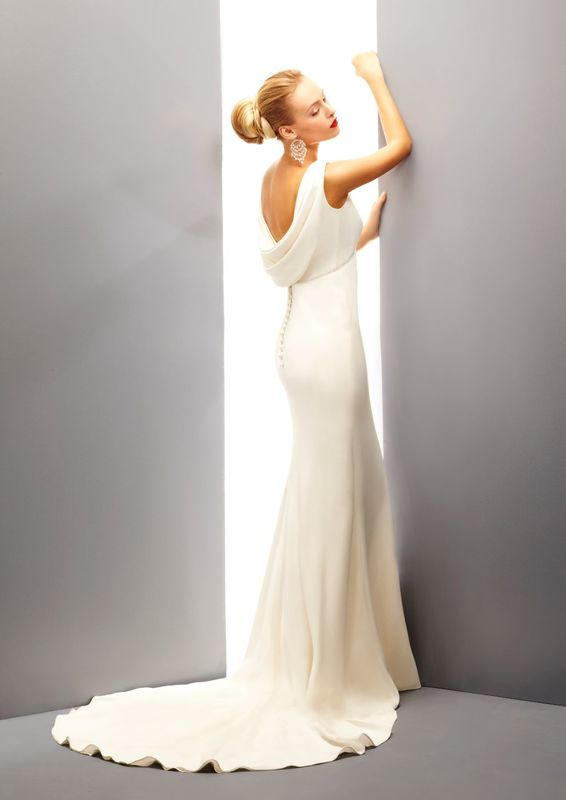 Ritva Westenius 'Levezza' Flattering column dress with boat neckline and a draped cowl at the low back bodice. Fabric used is Italian double crepe, beaded in crystals on under-bust and shoulder.
