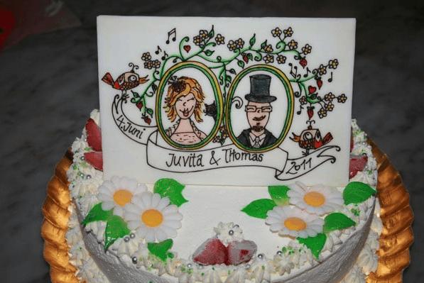 Beispiel: Hochzeitstorte, Foto: Café - Konditorei Müller.