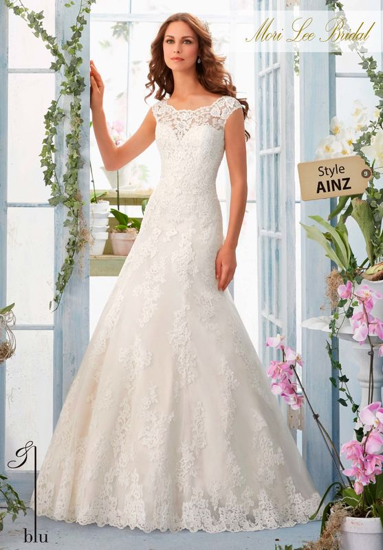 """Dress Style AINZ  EMBROIDERED LACE APPLIQUES AND SCALLOPED HEMLINE ON NET GOWN OVER SOFT SATIN  Available in Three Lengths: 55"""", 58"""", 61"""". Colors Available: White, Ivory, Ivory/Coco."""