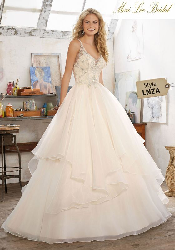 Dress style LNZA Madison Wedding Dress Colors Available: White/Silver, Ivory/Silver, Champagne/Silver. Shown in Champagne/Silver.