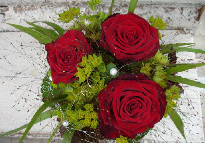 Beispiel: Festlicher Blumenschmuck, Foto: Haus Blumengeschäft und Gärtnerei.