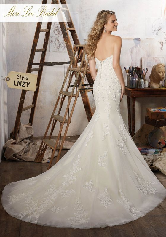 Dress style LNZY Magnolia Wedding Dress Available in Three Lengths: 55″, 58″, 61″. Colors Available: White, Ivory, Light Gold. Shown in Ivory/Light Gold.