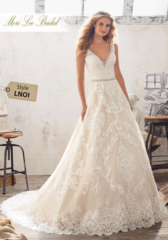 Dress style LNOI Morgan Wedding Dress Available in Three Lengths: 55″, 58″, 61″. Colors Available: White, Ivory, Ivory/Light Gold. Shown in Ivory/Light Gold.
