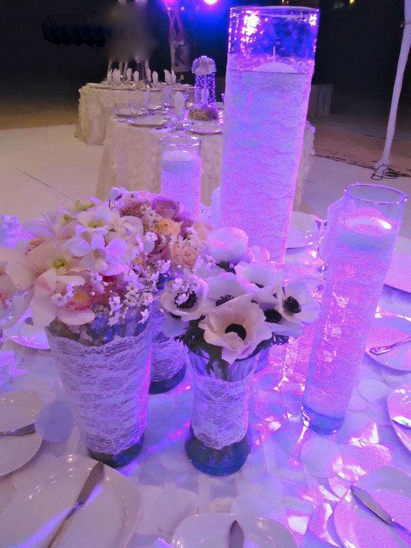 cilindros con velas y mix de flores