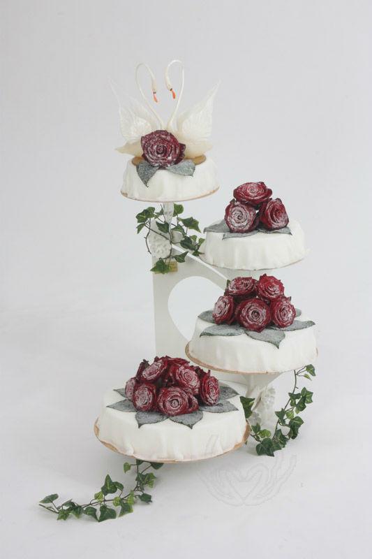 Beispiel: Hochzeitstorten, Foto: Tortenkunstwerke.