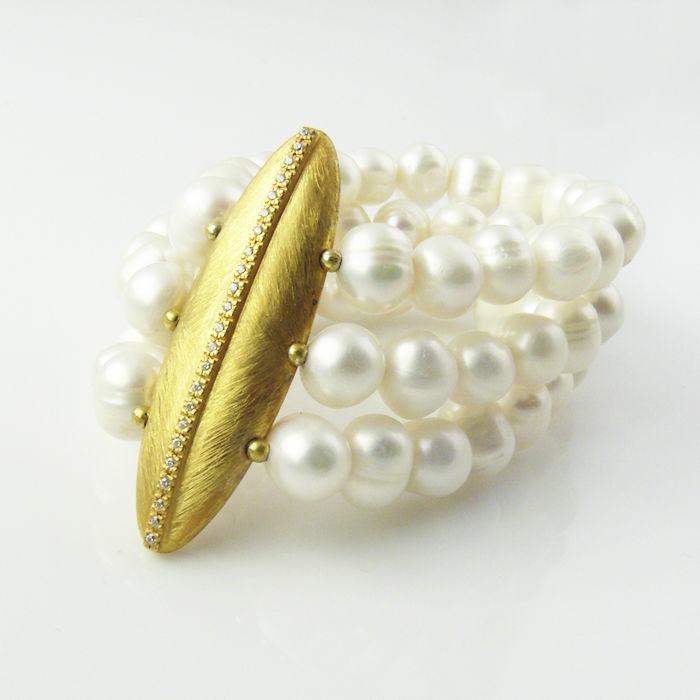 Pulsera L Isis·P en plata de ley bañada en oro, perlas y circonita