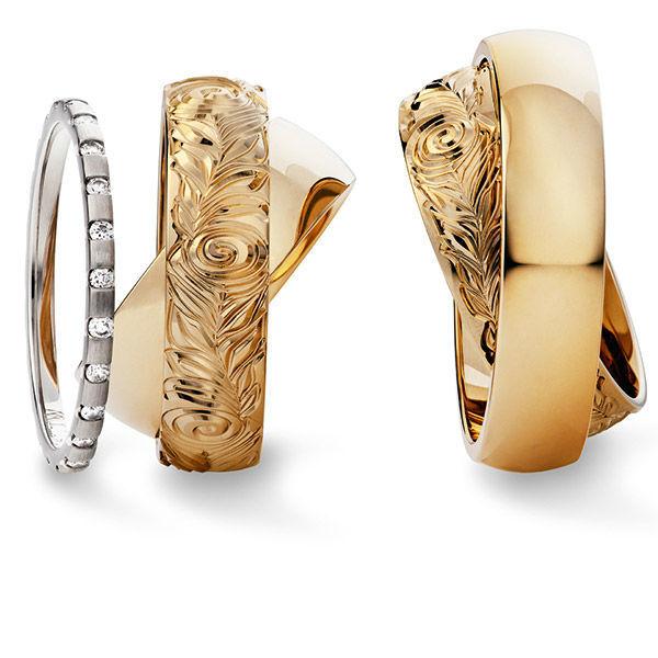 Beispiel: Trauringe - Gold mit Verlobungsring, Foto: Juwelier Stöckle.