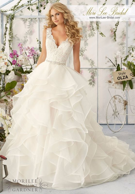 """Dress Style OLZA Venice Lace Appliques Sprinkled With Delicate Beading Onto The Flounced Organza Skirt  Removable Beaded Satin Belt. Available in Three Lengths: 55"""", 58"""", 61"""". Colors available: White, Ivory, Ivory/Light Gold, Ivory/Blush."""