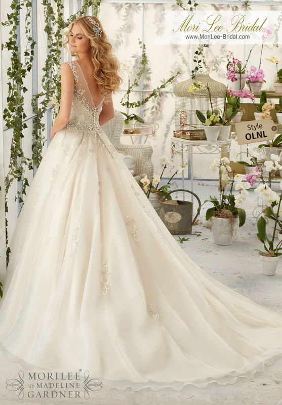 Dress Style OLNL Intricate Crystal Beaded Embroidery Decorates The Tulle Ball Gown  Colors available: White/Silver, Ivory/Silver, Light Gold/Silver.