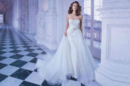Beispiel: Schlichtes Brautkleid, Foto: Brautmode Milojka.