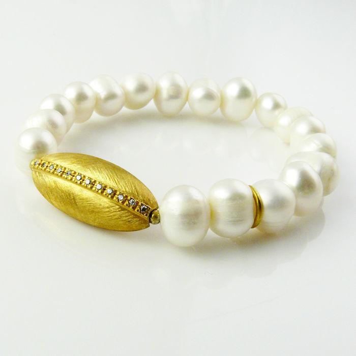 Pulsera S Isis·P en plata de ley bañada en oro, perlas y circonita