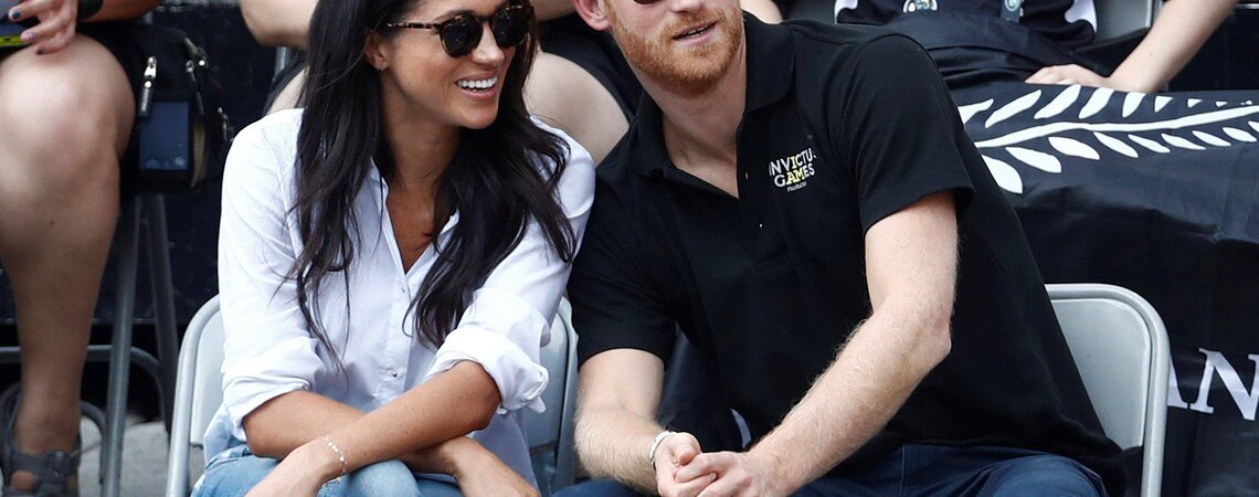 FILE PHOTO: Britain's Prince Harry (R) sits with girlfriend actress Meghan Markle to watch a wheelchair tennis event during the Invictus Games in Toronto, Ontario, Canada September 25, 2017.   REUTERS/Mark Blinch/File PhotoCODE: X02025