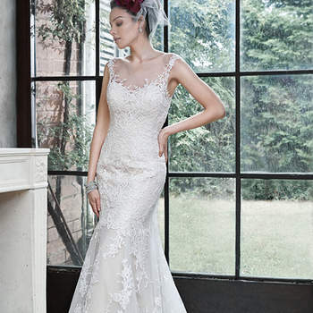 "Elegant romance is found in this soft fit and flare gown, constructed of delicate tulle and lace. Finished with illusion neckline, dramatic illusion back, and pearl buttons over zipper closure.  <a href=""http://www.maggiesottero.com/dress.aspx?style=5MB657"" target=""_blank"">Maggie Sottero</a>"