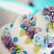 Des roses aux couleurs pastels subliment ce gâteau de mariage ! - Photo : 2Rings Trouwfotografie & Feeststudio