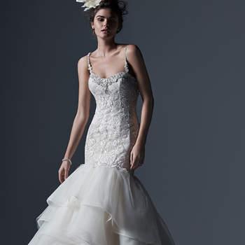 """Cette robe de mariée au corsage de dentelle et à la jupe volumineuse est en organza. On aime les différentes couches de la jupe  et les cristaux de Swarovski glamour qui ornent le décolleté.    <a href=""""http://www.sotteroandmidgley.com/dress.aspx?style=5SW678"""" target=""""_blank"""">Sottero &amp; Midgley</a>"""