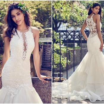 """Beaded lace motifs and Swarovski crystals adorn the bodice, illusion back, and halter neckline with illusion plunging V in this wedding dress. A tiered tulle and Marquice Organza skirt with horsehair edging completes this fit-and-flare silhouette. Finished with crystal buttons over zipper closure.   <a href=""""https://www.maggiesottero.com/maggie-sottero/veda/11197?utm_source=zankyou&amp;utm_medium=gowngallery"""" target=""""_blank"""">Maggie Sottero</a>"""