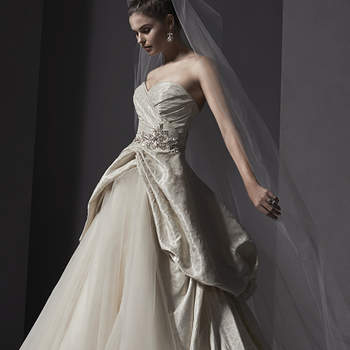 """Brocade drapes the bodice of this ballgown before cascading into a voluminous cut-away skirt revealing tulle, accented with Swarovski crystal appliqué and sweetheart neckline. Finished with covered buttons over zipper and inner corset closure.   <a href=""""http://www.sotteroandmidgley.com/dress.aspx?style=5SW135"""" target=""""_blank"""">Sottero and Midgley Spring 2015</a>"""