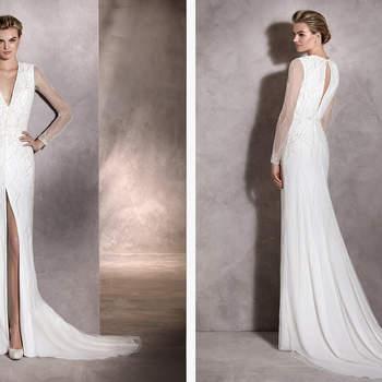 Hochzeitskleid aus Tüll, eleganten Strass-Applikationen, langen Ärmeln und V-Ausschnitt. Modern und sehr einprägsam!