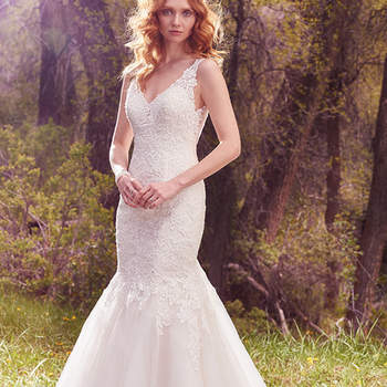 "Lace appliqués accented in pearls and beading adorn the bodice and illusion straps in this gorgeous fit-and-flare, featuring a V-neckline, low back, and tulle over Chic organza skirt. Finished with covered buttons over zipper closure.  <a href=""https://www.maggiesottero.com/maggie-sottero/chardonnay/10094?utm_source=mywedding.com&amp;utm_campaign=spring17&amp;utm_medium=gallery"" target=""_blank"">Maggie Sottero</a>"