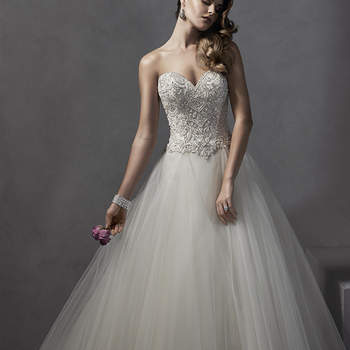 "Decadent Swarovski crystals and pearls adorn the bodice of this romantic ballgown, complete with voluminous tulle skirt and dramatic sweetheart neckline. Finished with crystal button over zipper and inner corset closure.  <a href=""http://www.sotteroandmidgley.com/dress.aspx?style=5SS125"" target=""_blank"">Sottero and Midgley Spring 2015</a>"