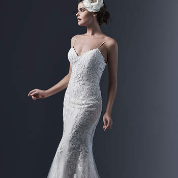Refined elegance is found in this chic lace sheath wedding dress; accented with sexy spaghetti straps; demure illusion back and V-neckline. Finished with pearl buttons and zipper closure. <img height='0' width='0' alt='' src='http://ads.zankyou.com/mn8v' />