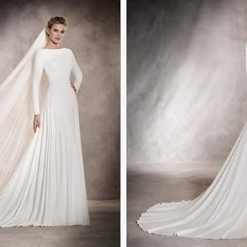 Ein Hochzeitskleid aus Krepp und Tüll im dezenten Meerjungfrauen-Stil. Die perfekte Kombination aus Einfachheit und Fantasie.