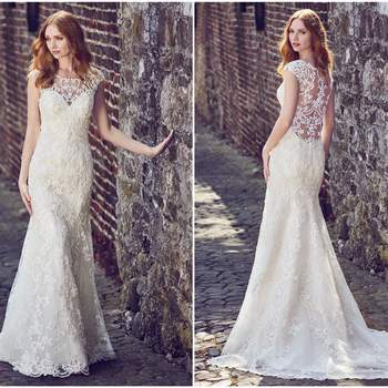 """This elegant fit-and-flare wedding dress features a tulle overlay of beaded lace motifs, creating an illusion bateau over sweetheart neckline, illusion cap-sleeves, illusion scoop back, and beautiful scallop hemline. Finished with pearl buttons and zipper closure.  <a href=""""https://www.maggiesottero.com/maggie-sottero/everly/11170?utm_source=zankyou&amp;utm_medium=gowngallery"""" target=""""_blank"""">Maggie Sottero</a>"""