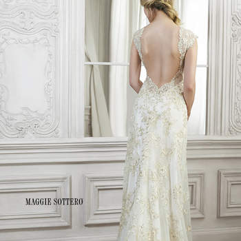 "Floral appliques glisten along the length of this gorgeous lace sheath dress, complete with illusion sweetheart neckline and plunging back. Finished with crystal button over zipper closure.  <a href=""http://www.maggiesottero.com/dress.aspx?style=5MR132"" target=""_blank"">Maggie Sottero Spring 2015</a>"