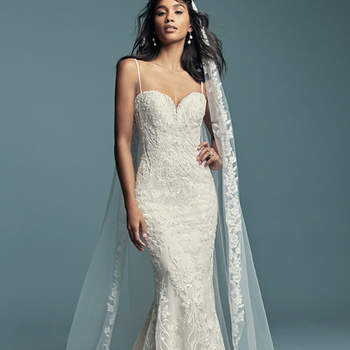 """<a href=""""https://www.maggiesottero.com/maggie-sottero/gwendolyn/11479"""">Maggie Sottero</a>  Beaded lace motifs cascade over tulle in this sexy fit-and-flare wedding dress, featuring a sweetheart neckline and beaded spaghetti straps. Finished with covered buttons over zipper and inner corset closure. Detachable veil accented in beaded lace motifs sold separately. Detachable train accented in beaded lace sold separately."""
