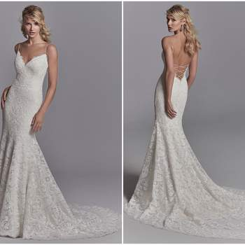 "Allover lace motifs drift over tulle and Inessa Jersey in this sexy fit-and-flare wedding dress, accenting the illusion triple-tiered train. Spaghetti straps glide from the V-neckline to crisscross strap details over the plunging back. Finished with zipper closure.  <a href=""https://www.maggiesottero.com/sottero-and-midgley/maxwell-rose/11218?utm_source=zankyou&amp;utm_medium=gowngallery"" target=""_blank"">Sottero and Midgley</a>"