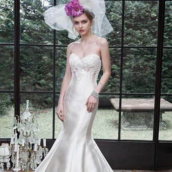 """Rico e luxuoso Elodie Mikado cria este vestido de noiva sereia, com saia volumosa e rendas adornando o corpete,  com cristais Swarovski. Acabamento em decote coração e feche tipo espartilho.  <a href=""""http://www.maggiesottero.com/dress.aspx?style=5MS619"""" target=""""_blank"""">Maggie Sottero</a>"""