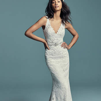 """<a href=""""https://www.maggiesottero.com/maggie-sottero/caroline/11422"""">Maggie Sottero</a>  Classic yet boho-inspired, this allover A-line lace wedding dress features lace motifs along the bodice, V-neckline, straps, and scoop back. Complete this look with an optional beaded belt (BB8MC650). Finished with covered buttons over zipper closure."""