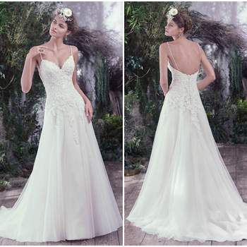 "Delicate beaded spaghetti straps and a feminine V-neckline add ethereal touches to this A-line wedding dress. Swarovski crystals and beading adorn a fitted lace bodice before falling into a weightless tulle skirt. Finished with covered buttons over zipper and inner corset closure.  <a href=""https://www.maggiesottero.com/maggie-sottero/beth/9739"" target=""_blank"">Maggie Sottero</a>"