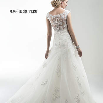 "Embroidered floral appliques adorn an elegant tulle skirt embellished with twinkling sequins and demure illusion lace back. Finished with zipper back and button down closure.  <a href=""http://www.maggiesottero.com/dress.aspx?style=4MW012"" target=""_blank"">Maggie Sottero Platinum 2015</a>"