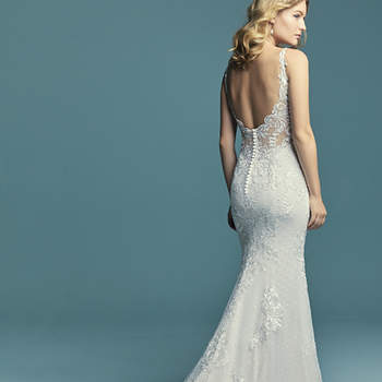 "<a href=""https://www.maggiesottero.com/maggie-sottero/lucienne/11277"">Maggie Sottero</a>  Lace motifs waltz over dotted tulle in this boho sheath wedding dress, completing the illusion sweetheart neckline and illusion scoop back. Lined with Cypress Jersey for a luxe fit. Finished with covered buttons over zipper closure. Detachable illusion poet sleeves accented in lace motifs sold separately."