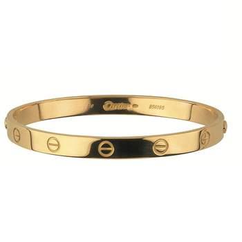 Bracelete dourado. Credits: Cartier