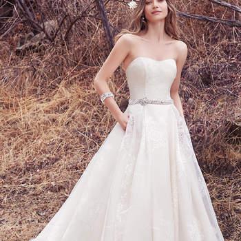 Süß und elegant: dieses Brautkleid besteht aus Organza und kommt trägerlos daher.
