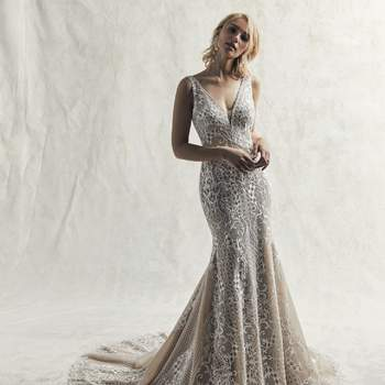 A regal yet alluring design, this fit-and-flare wedding dress features embroidered lace motifs on tulle.