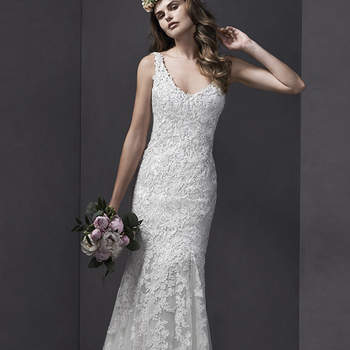 """Modern romance is found in this A-Line wedding dress, paired with tulle and traditional lace. Complete with plunging V-neckline and straps. Finished with zipper over inner elastic closure.  <a href=""""http://www.sotteroandmidgley.com/dress.aspx?style=5SB148"""" target=""""_blank"""">Sottero and Midgley Spring 2015</a>"""